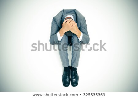 businessman curled up in the floor with his head between his kne stock photo © nito