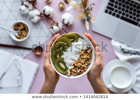 Femminile mani ciotola cereali computer portatile immagine Foto d'archivio © deandrobot