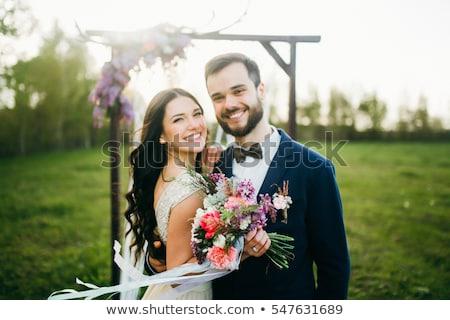 fiatal · esküvő · pár · csók · kint · élvezi - stock fotó © artfotodima