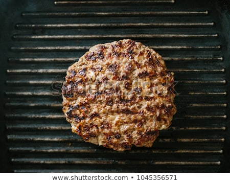 serpenyő · sült · részlet · étel · fekete · hamburger - stock fotó © Digifoodstock