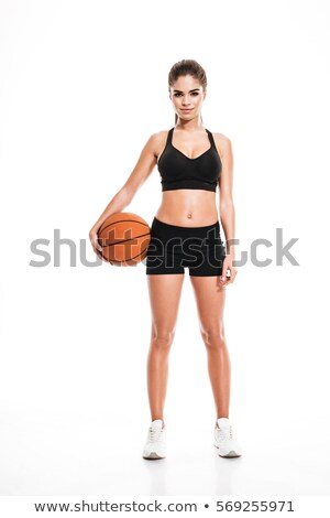 female basketball player isolated over a black background stock photo © deandrobot