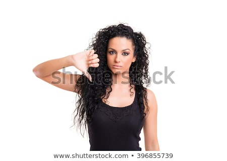 Mad young girl with thumb down on white background studio Stock photo © artfotodima
