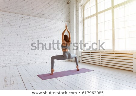 Woman in bound angle yoga pose meditating at sunset. Zen Stock photo © photocreo