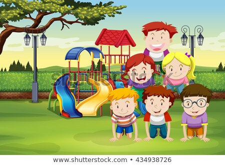 Kids doing human pyramid in the park Stock photo © bluering