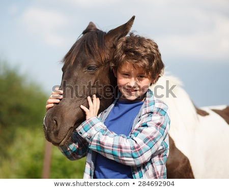 Young boy and a horse Stock photo © bluering