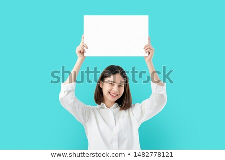 young asian woman holding white paper card stock photo © szefei