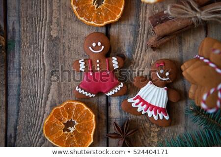 Christmas cookies, Gingerbread man old wooden background. Flat l Stock photo © Yatsenko