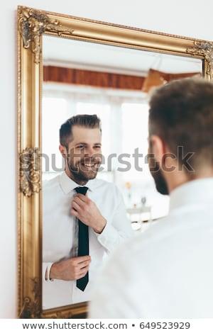 adam · bakıyor · ayna · takım · elbise - stok fotoğraf © tommyandone