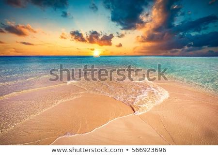 Pôr do sol praia casa natureza oceano viajar Foto stock © Pakhnyushchyy