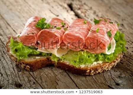 Pan de trigo entero salchicha rebanadas madera pan Foto stock © Digifoodstock