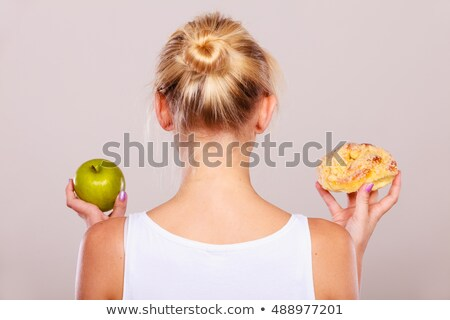 Woman comparing sweets. Stock photo © IS2