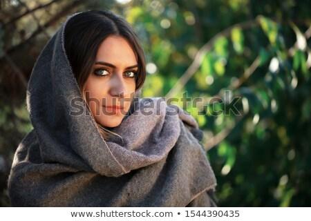 Csinos közel-keleti nő szürke mosoly arc Stock fotó © keeweeboy