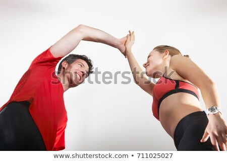 Couple in running gear high fiving Stock photo © IS2