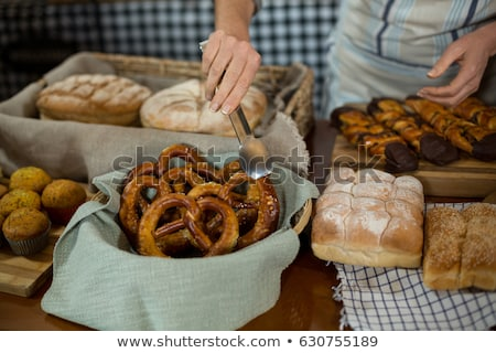 Staff holding cookies with tong in bakery shop Stock photo © wavebreak_media