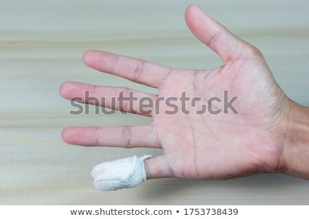 Injured finger with bloody bandage Stock photo © CsDeli