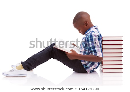 young black boy student sits on stack of books stock photo © vectorikart