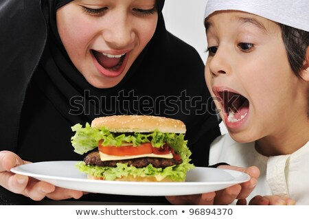 Sister eating sandwich by brother eating cheeseburger Stock photo © monkey_business
