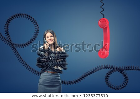 Businesswoman with Phone Receiver and Cord Stock photo © CsDeli