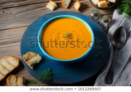 Pumpkin soup in bowl sprinkled with herbs Stock photo © dash