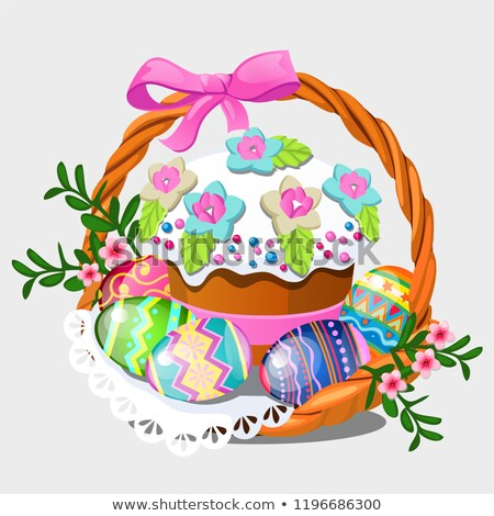 Wicker basket with set of colorful eastern eggs, flowers and Easter cake isolated on white backgroun Stock photo © Lady-Luck