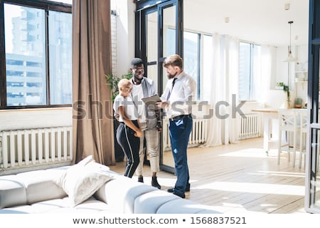 cheerful young multiethninc couple stock photo © deandrobot