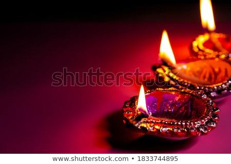 creative diya design on purple background stock photo © sarts