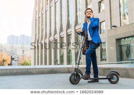 Jóképű fiatal üzletember sétál kint moped Stock fotó © deandrobot