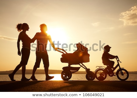How to Be Happy Family Parents with Perambulator Stock photo © robuart