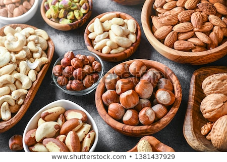 Stockfoto: Various nuts selection on wooden table