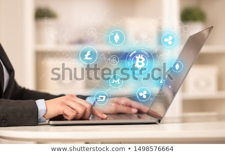 Stok fotoğraf: Business woman working on laptop with bitcoin link network and online concept