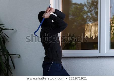 Thief Trying To Break The Window Stock photo © AndreyPopov