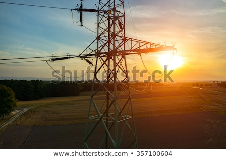 transmission tower and power line over blue sky Stock photo © dolgachov