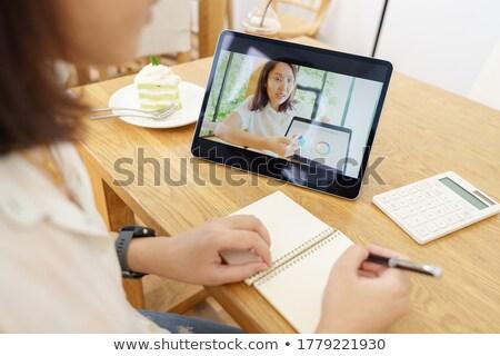 woman watching webinar on tablet computer at home Stock photo © dolgachov