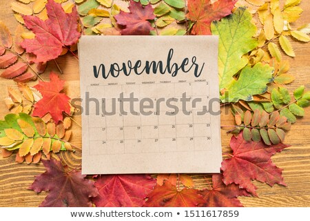 Square paper sheet of November calendar surrounded by yellow and red leaves Stock photo © pressmaster