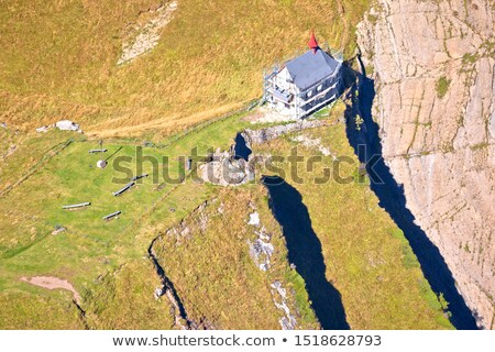 Aerial view of Klimsenkapelle chapel below Pilatus mountain peak stock photo © xbrchx