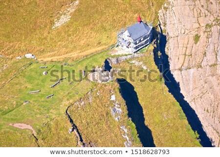 Chapelle au-dessous alpes Suisse Photo stock © xbrchx