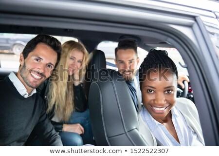 szczęśliwy · młodych · znajomych · posiedzenia · wewnątrz · samochodu - zdjęcia stock © andreypopov