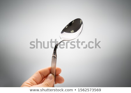 Person Holding Bend Stainless Steel Spoon Stock photo © AndreyPopov