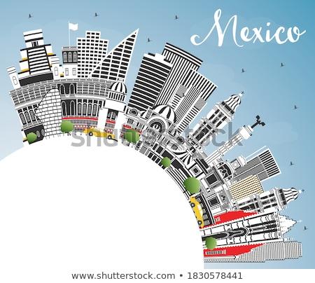 Mexico skyline with gray landmarks and blue sky. Stock photo © ShustrikS