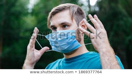 Hombre viajero desechable médicos máscara aeropuerto Foto stock © vkstudio