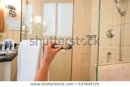 Stock photo: woman in the shower room_light