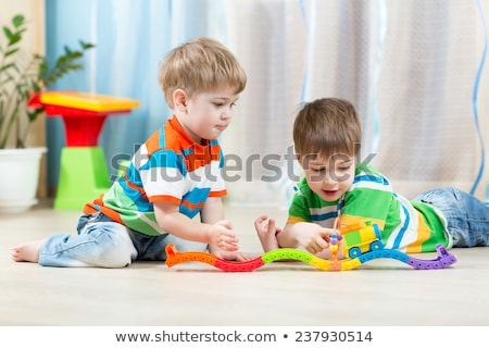 Boy plays with toy railroad in playroom Stock photo © Paha_L
