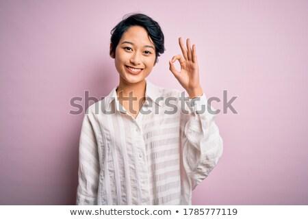 Succes okay handteken gelukkig jong meisje mooie Stockfoto © darrinhenry