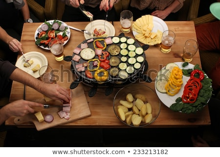 Friends eating raclette Stock photo © photography33