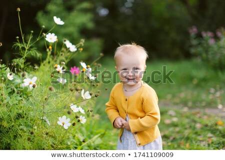baby girl with yellow flower stock photo © lovleah