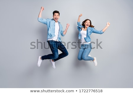 Fashion style photo of an attractive young couple celebrating va Stock photo © HASLOO