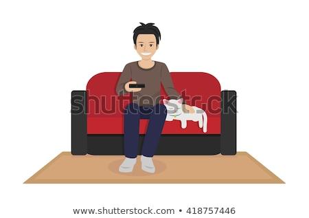 счастливым · человека · сидят · диване · джинсов - Сток-фото © hasloo