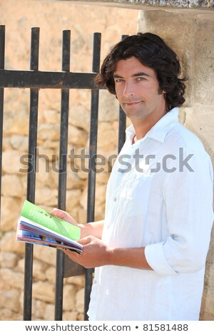 Male sightseer consulting a brochure Stock photo © photography33
