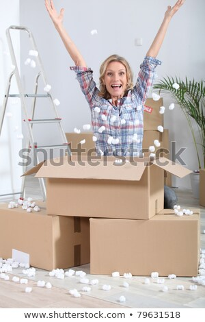 Woman crouching in front of stacked cardboard boxes Stock photo © photography33