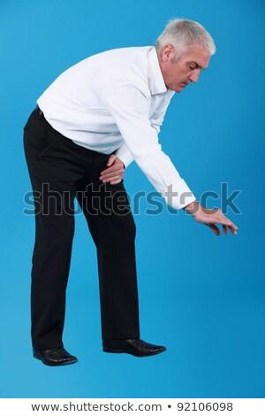 бизнесмен мнимый что-то вверх человека Сток-фото © photography33